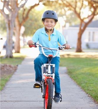 Boy riding bike harvest at limoneira