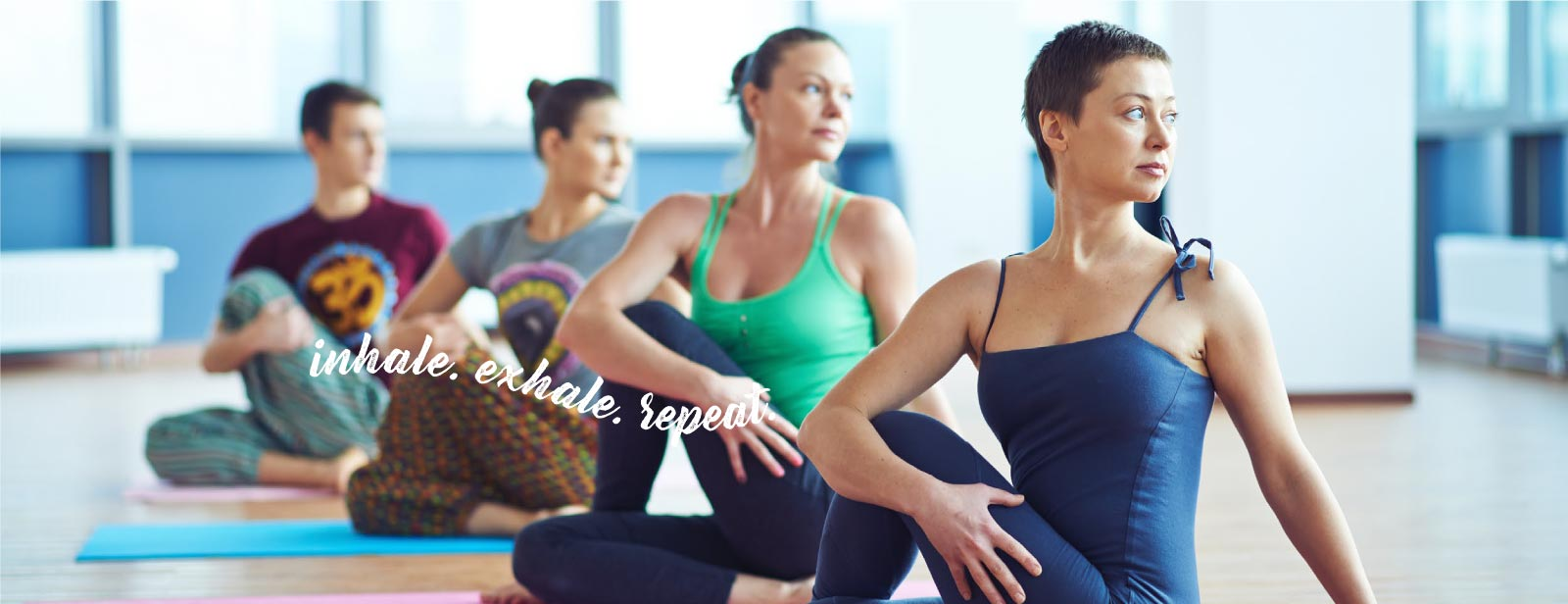 four people in a yoga class