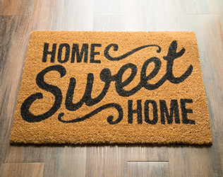 welcome mat that says Home Sweet Home