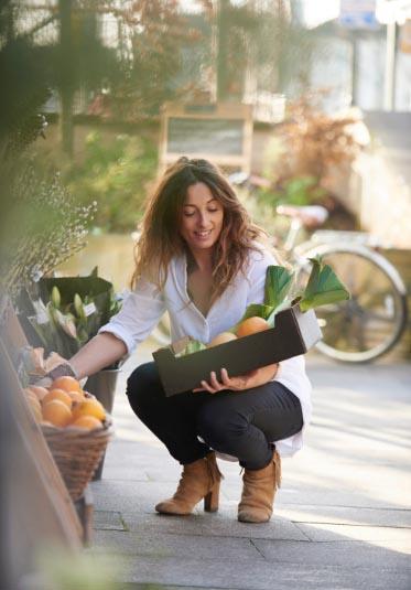 Woman picking fruit at a market