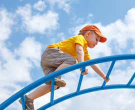 Kid climbing in playground